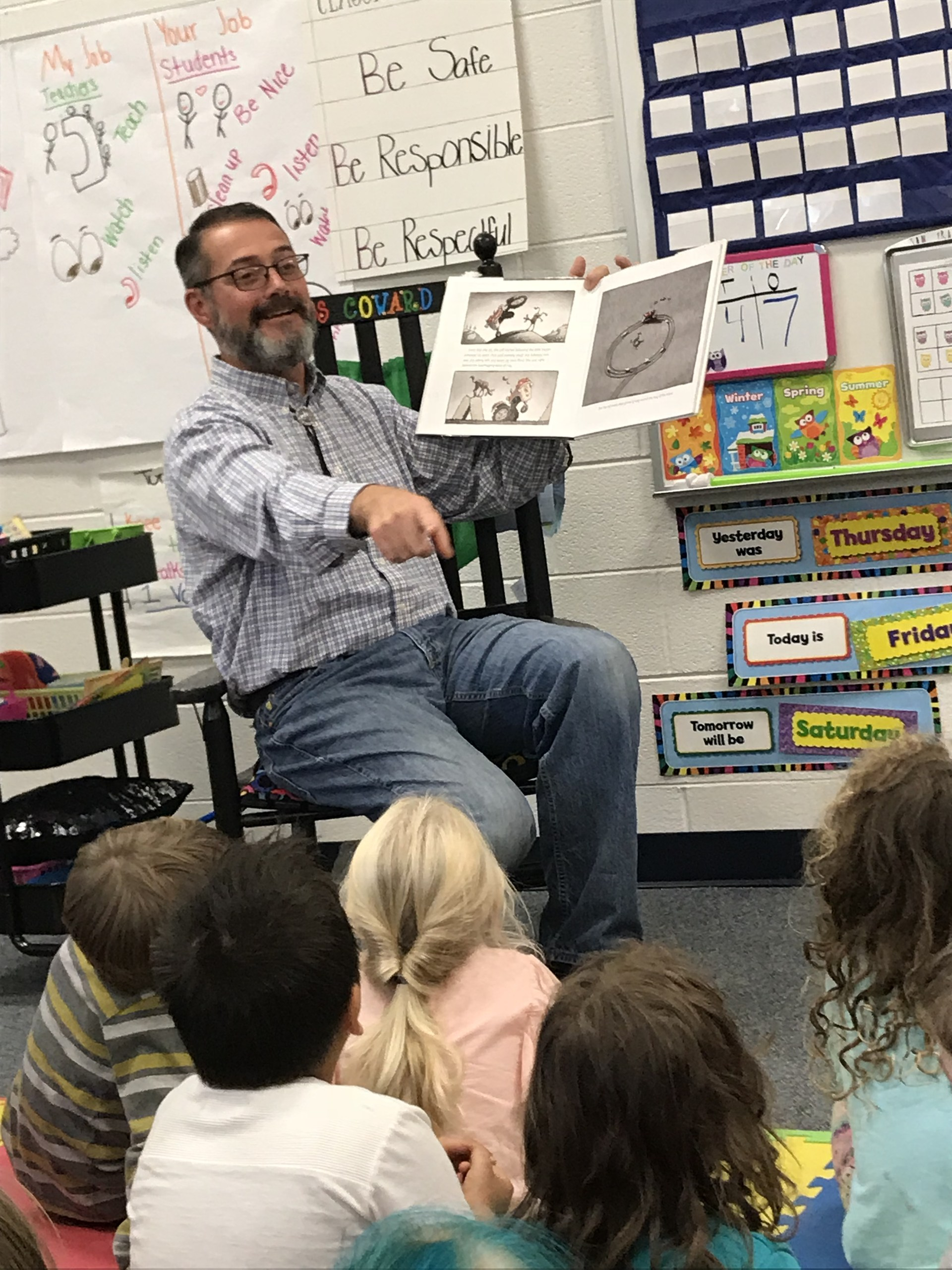 Principal Reads Book to Kindergaten
