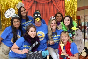 Fort Lewis Mesa staff posing in photo booth for convocation