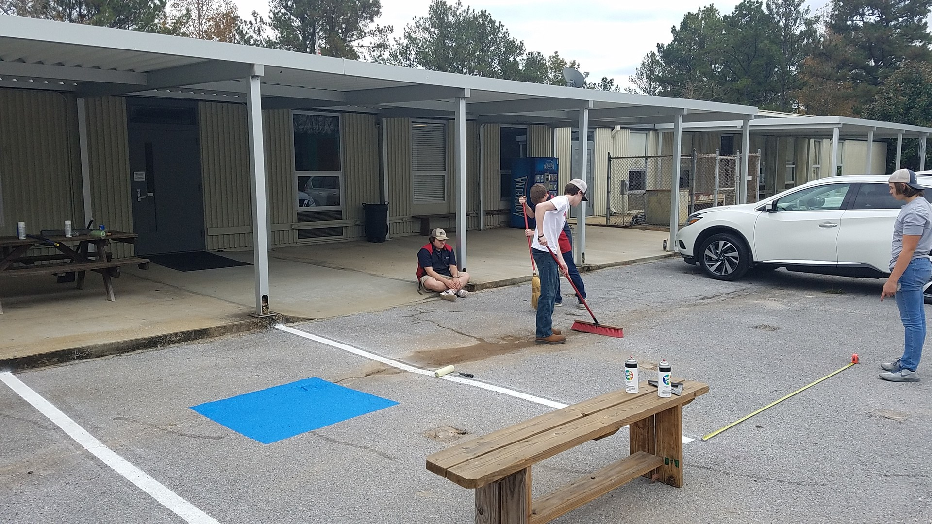 Auto students making handi-capped parking spots at BCCA.