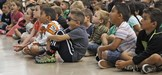 Castaic Elementary students react to photos of art in a slideshow presented by artist-in-residence Suzi Kades on Monday, Sept. 18, 2017. Kades will spend one week at the school completing a mural for the school. Katharine Lotze/The Signal