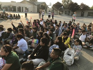 large group of students gathered for assembly outside, image 2