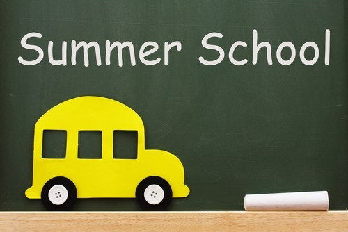 Summer School written on chalkboard with a school bus