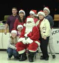 Santa at Cooke School with teachers and students