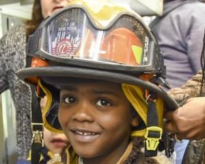 Preschooler wearing Fire Helmet