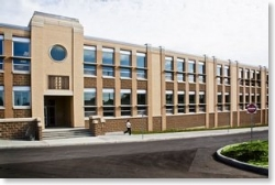 This is a picture of the middle school. It is a large brown, brick building.
