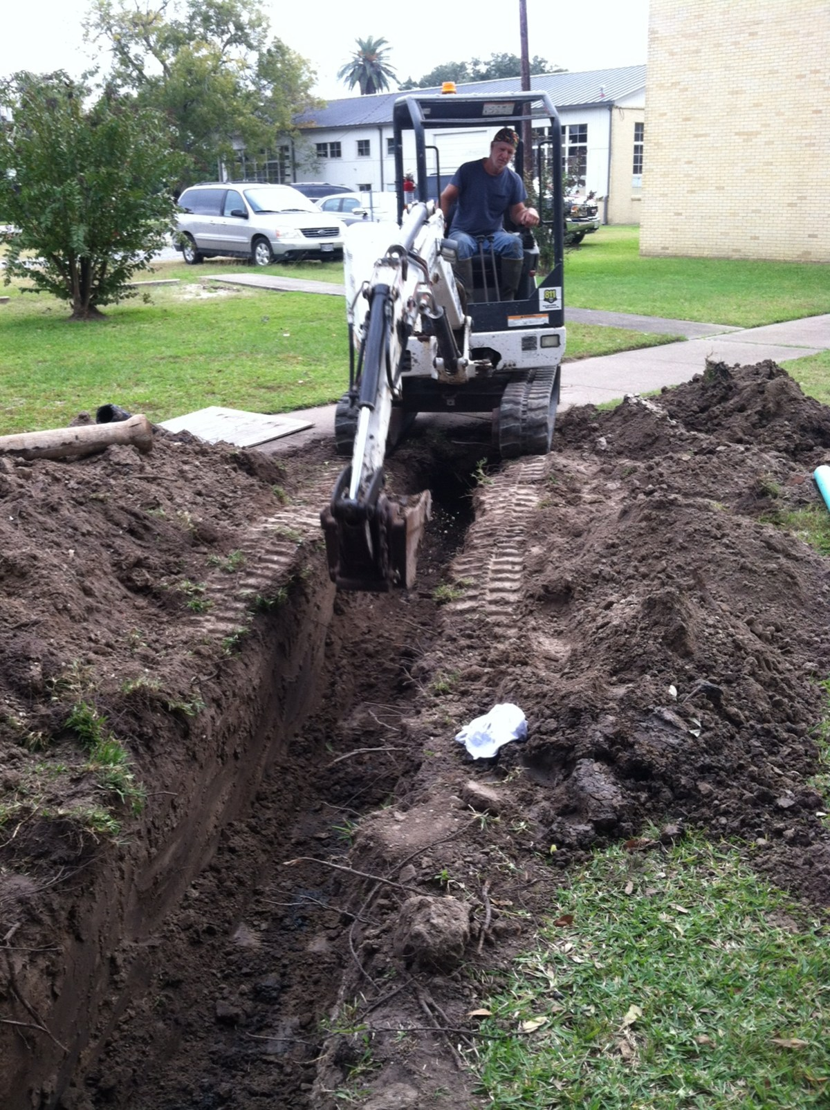 Maintenance worker digging a hole.