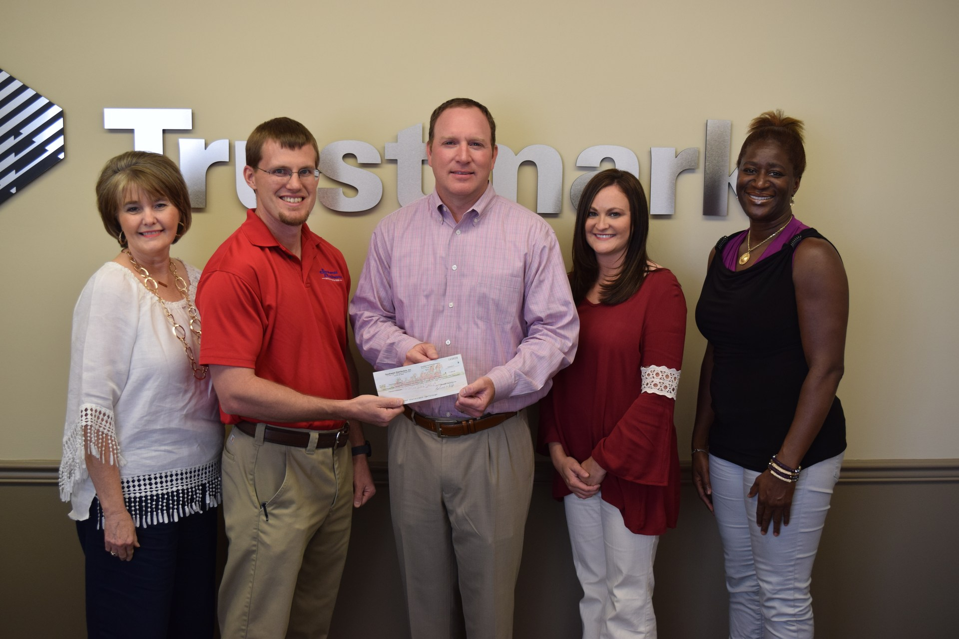 Soutwest Distributors donates to PIE.