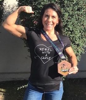 Brenna Rodriguez displays Legacy Medal
