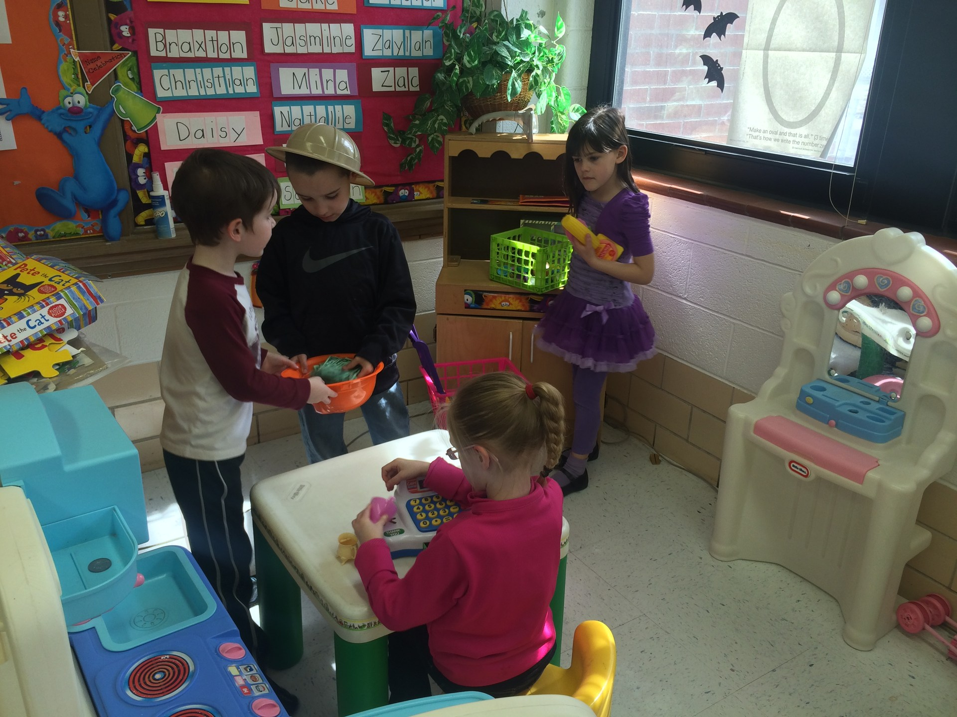 Kindergarten students playing grocery store.