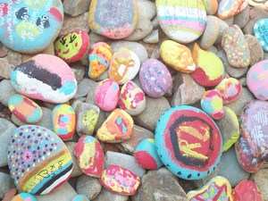 Decorated rocks in river bed.