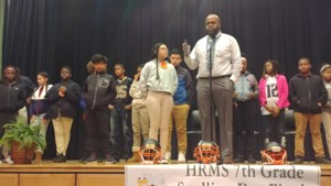 Baines celebrating spelling bee participants