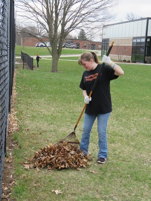 Students raked leaves from around the basketball court by McFall Elementary.