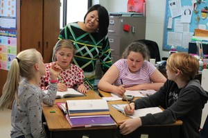 Mrs. Hardison goes over a homework assignment with her sixth grade students.