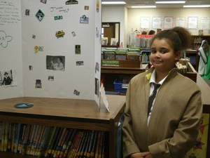 Student presenting in wax museum.