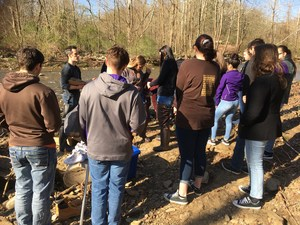 Environmental science students learn at the Montour Creek.