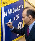 Joe Torri signing banner at the Margaret's Place Grand Opening EVent