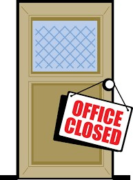 Door with window with office closed signage