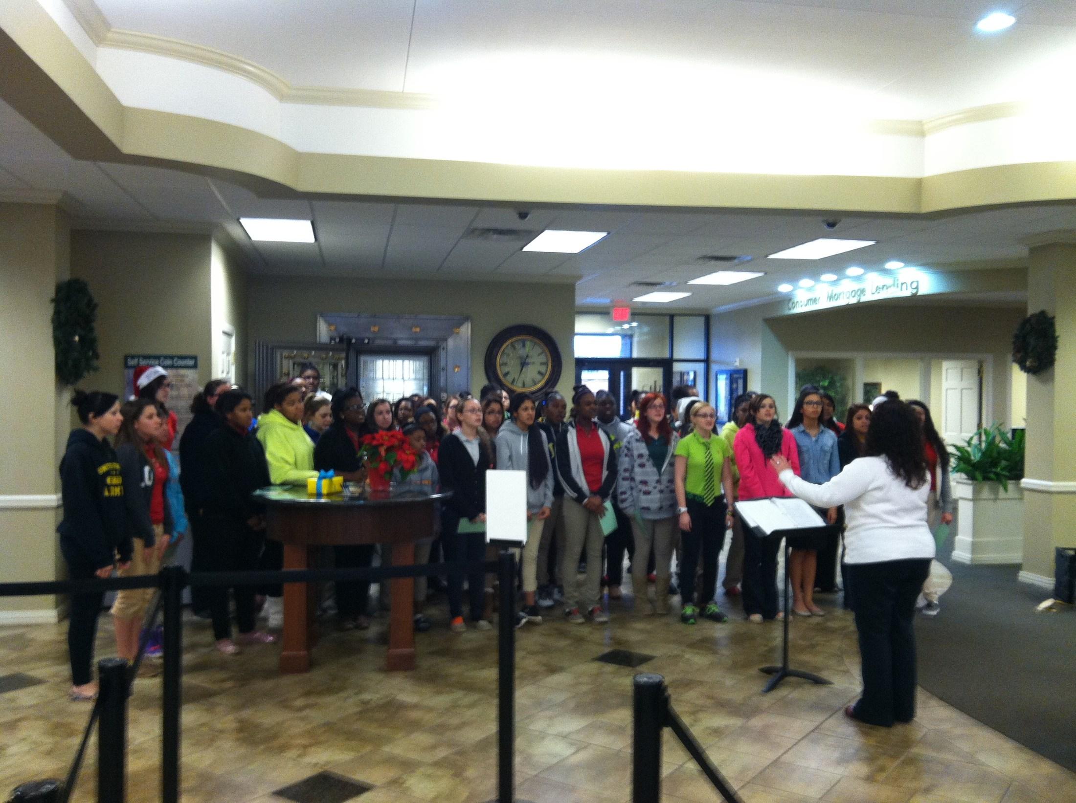 Girls singing at the bank