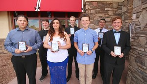 Hemet and San Jacinto's February Students of the Month standing with their plaques.