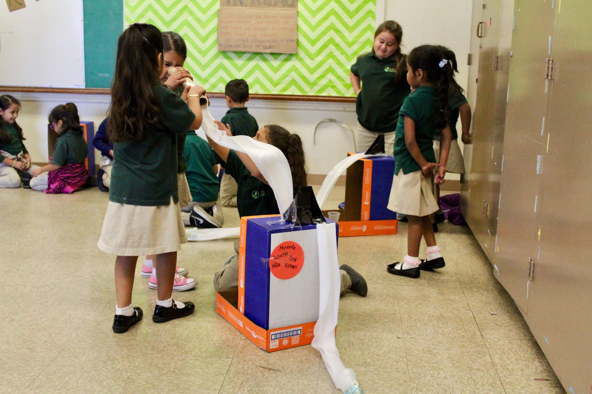 students create games with recycled materials