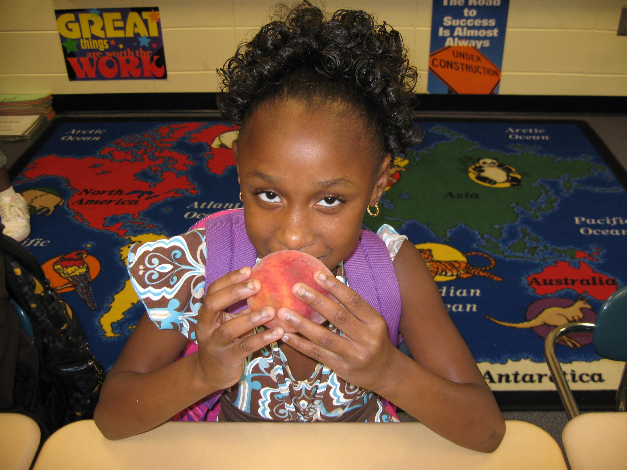 Student eating peach