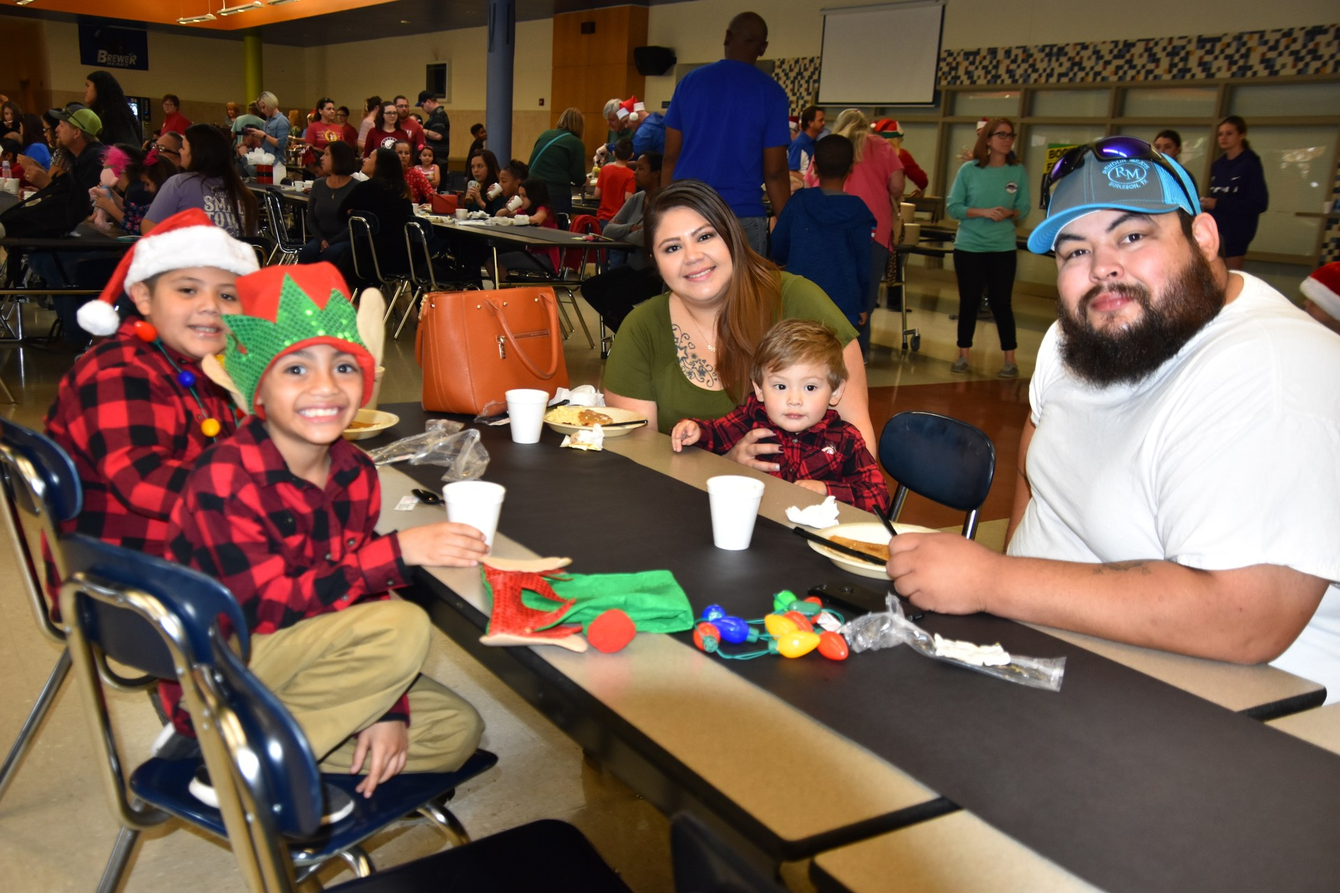 Families enjoy breakfast at Pancakes wth Santa.