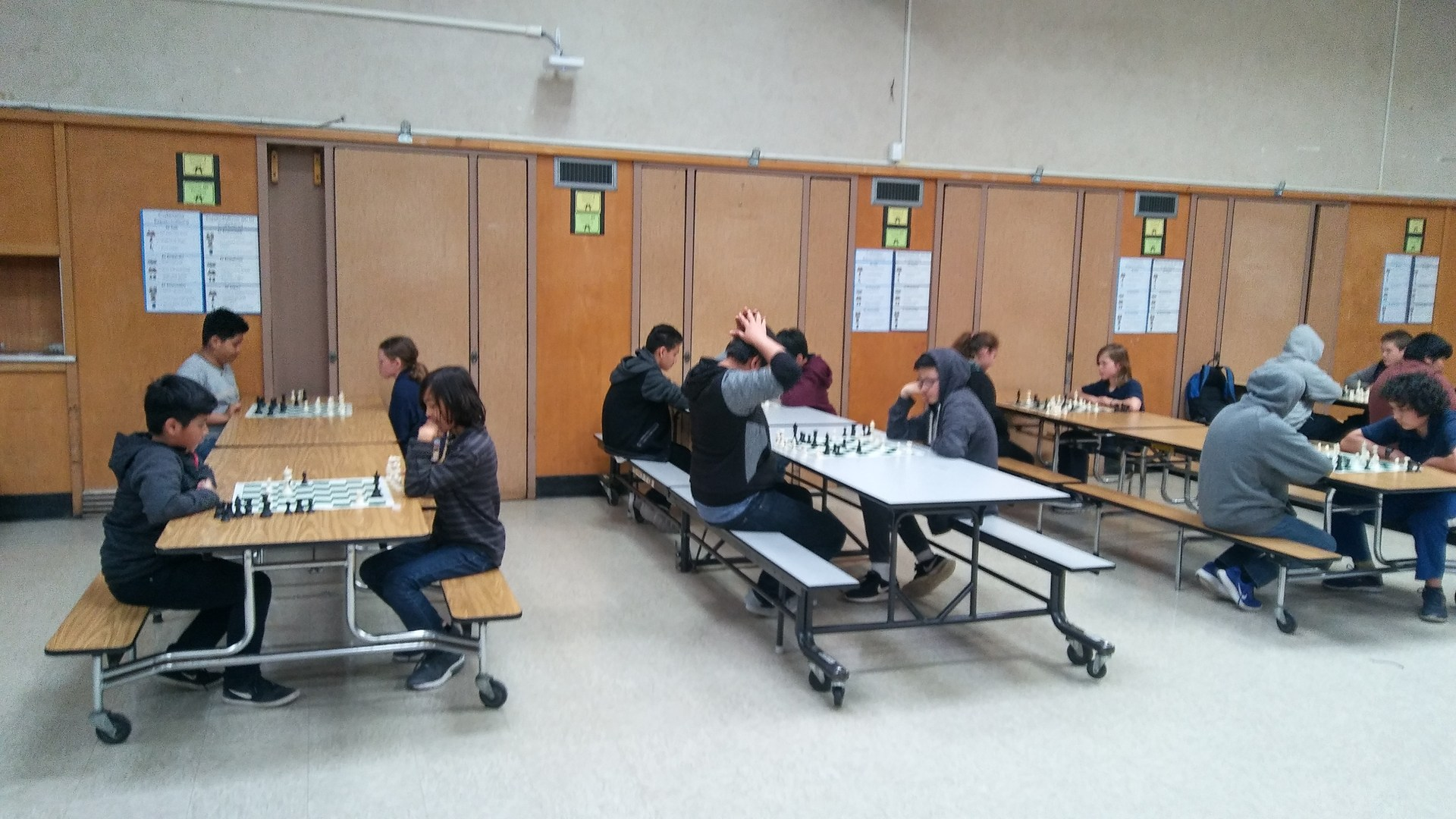 Middle School students playing chess.