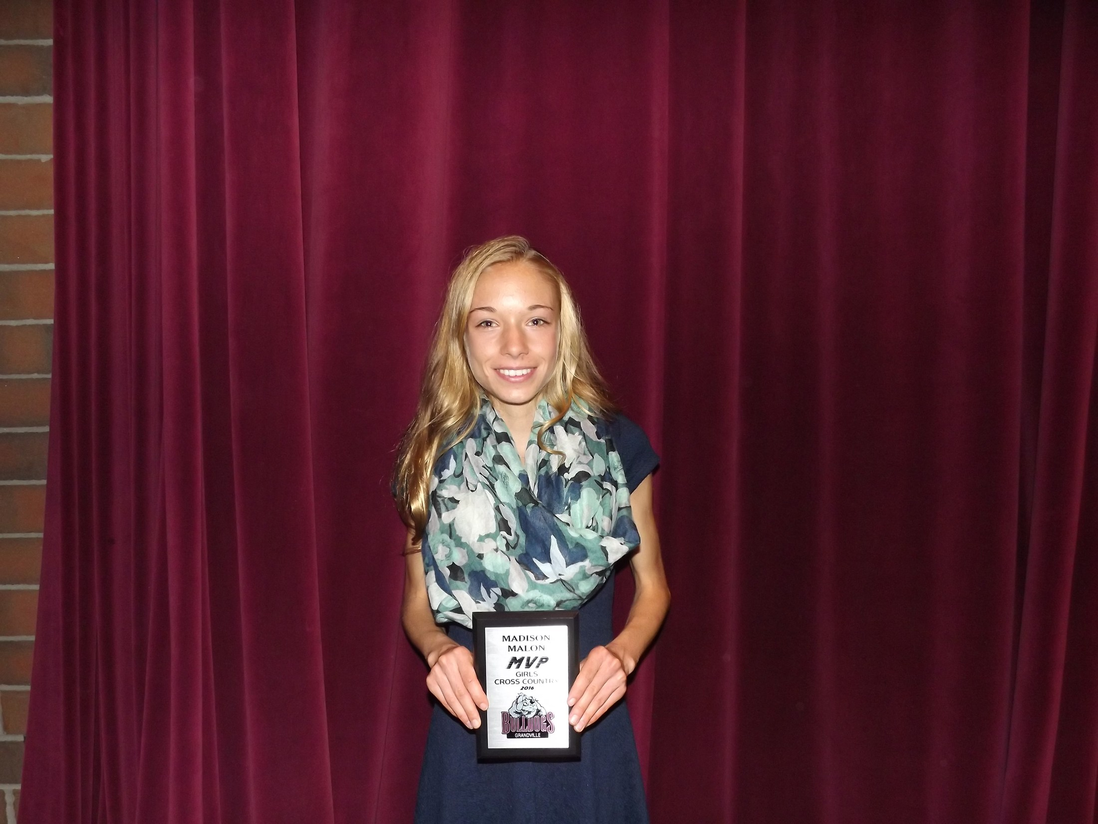 girl with cross country MVP award