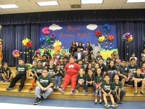 Students and Judge Keno Vasquez on stage after read aloud