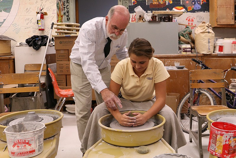Mr. Ressel & Student Making Pottery