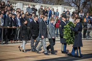 Isaac Olson laying a wreath at the Tomb of the Unknown Soldier