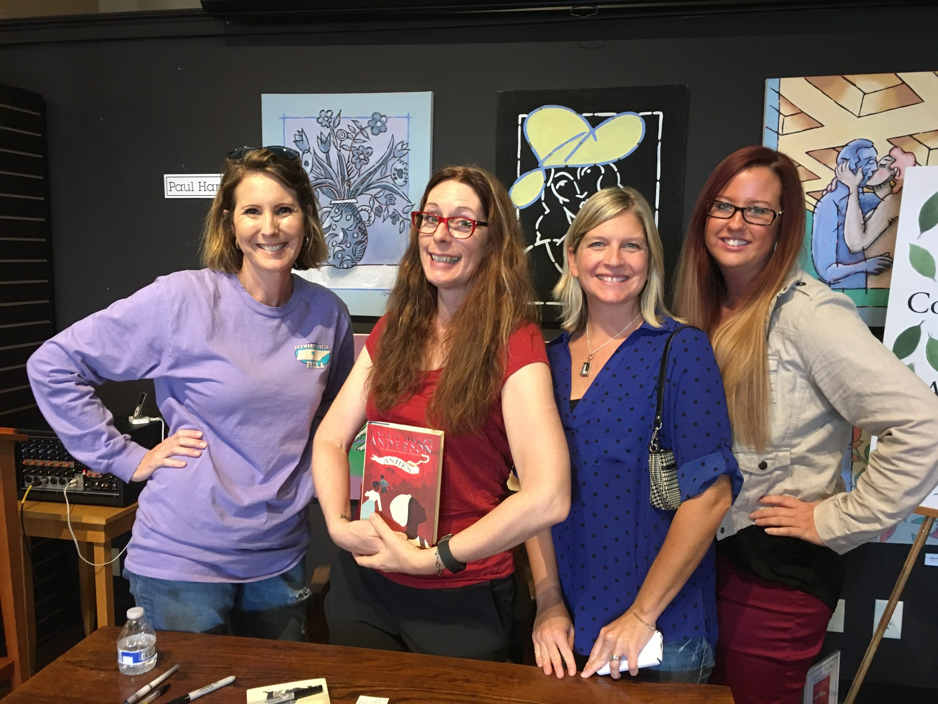 3 middle school librarians with author Laurie Halse Anderson
