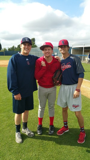 two YLHS players posing with a pony league player