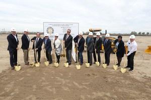 Dignitaries at the CTEC groundbreaking ceremony shoveling dirt.
