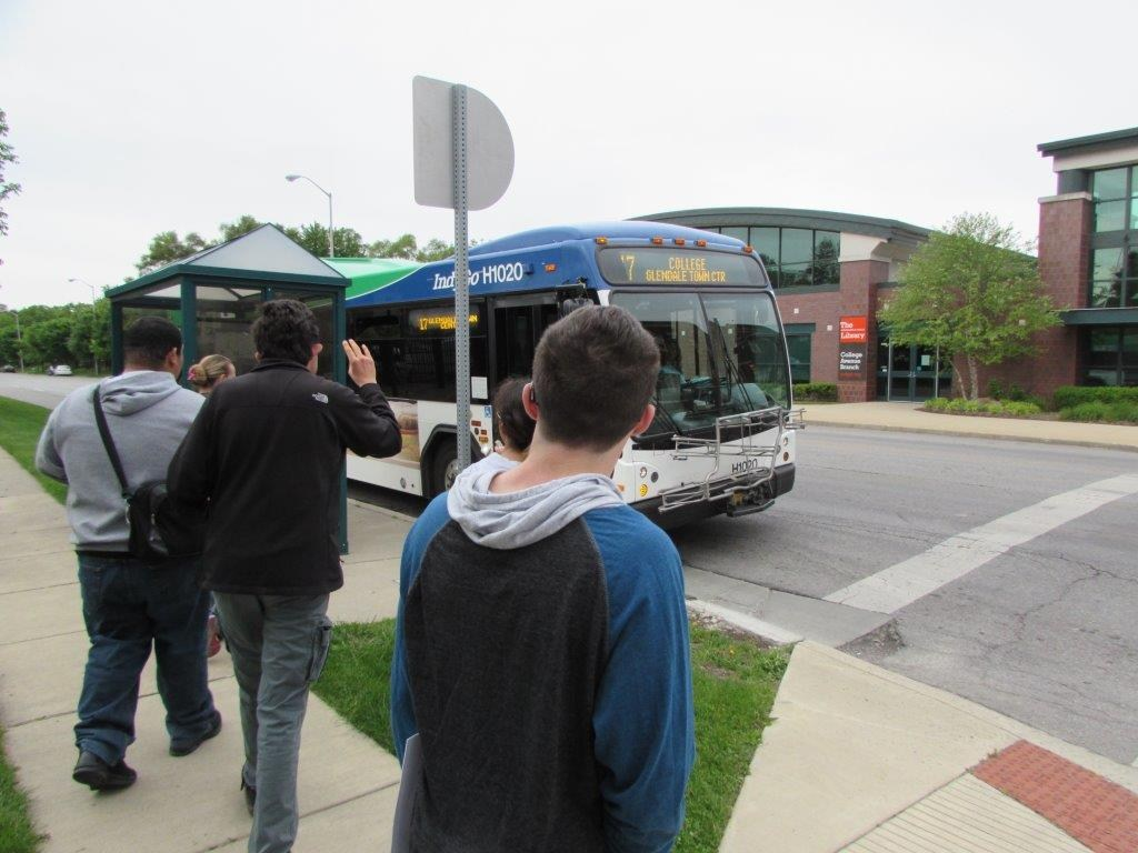 Oriole Academy Students catching the bus