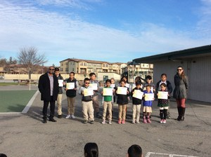 Students standing with their certificates