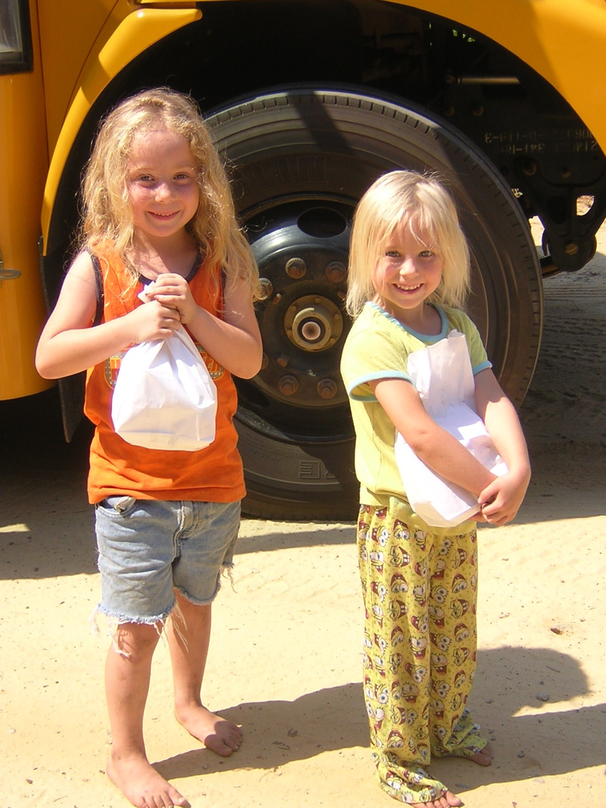 Children holding free bag lunch