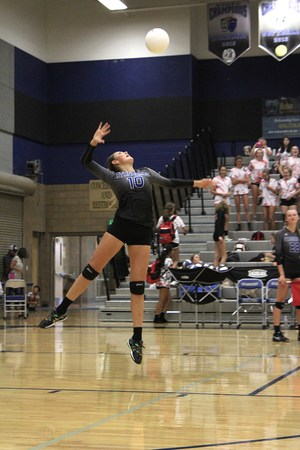 Volleyball player serves the ball