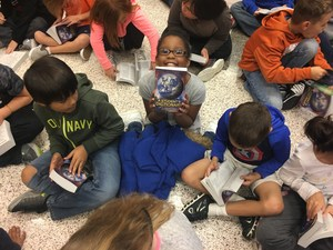 CCI third grade students get new dictionaries as a group