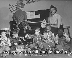 "ThrowbackThursday - Young children play musical insturments next to a piano with the quote ""Where words fail, music speaks"""