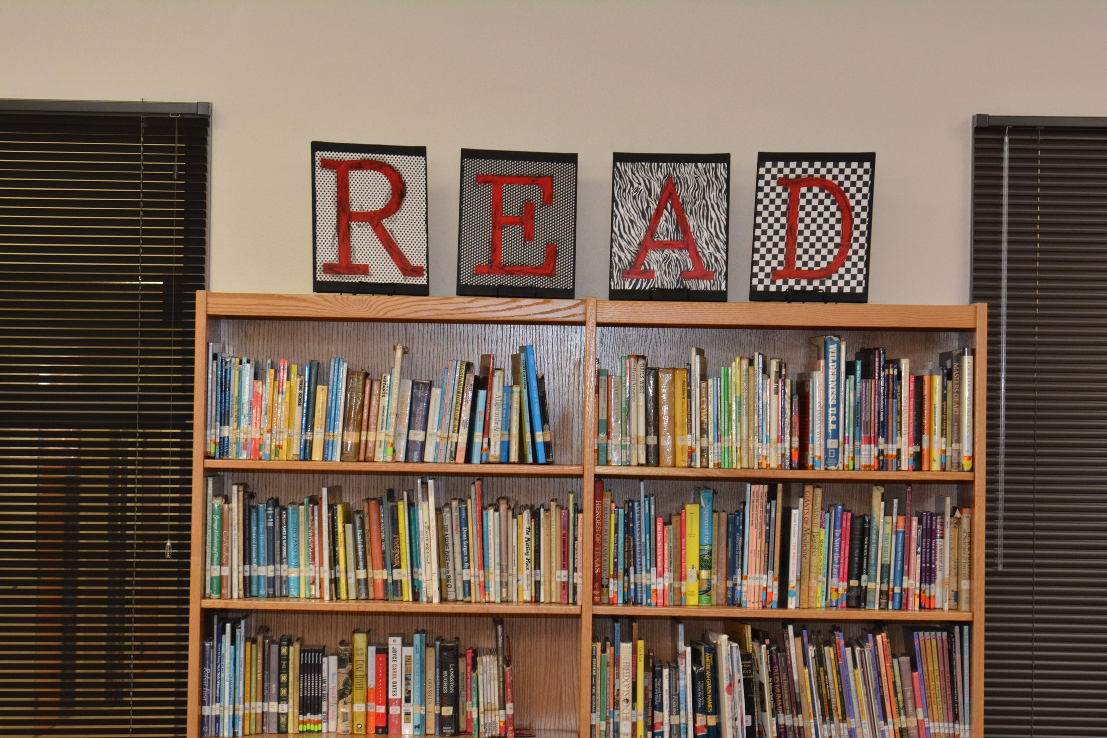 Middle School Library with READ above the shelf.
