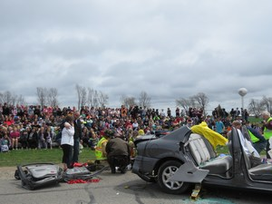 A mock car crash scene was staged Friday with an important life lesson about dangers of distracted driving and drunk driving.