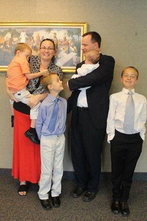 School Board Director of District 3, Seth Basford, with his four young boys and wife after church.