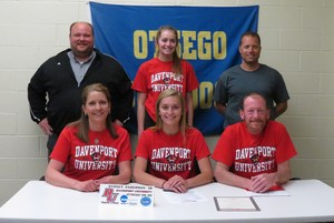 Sydney Anderson, with family and coaches, signs to high jump at Davenport.