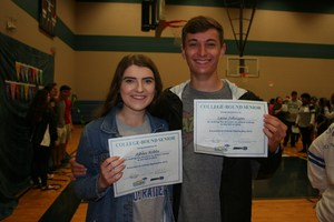 Students with their college signing day certificates