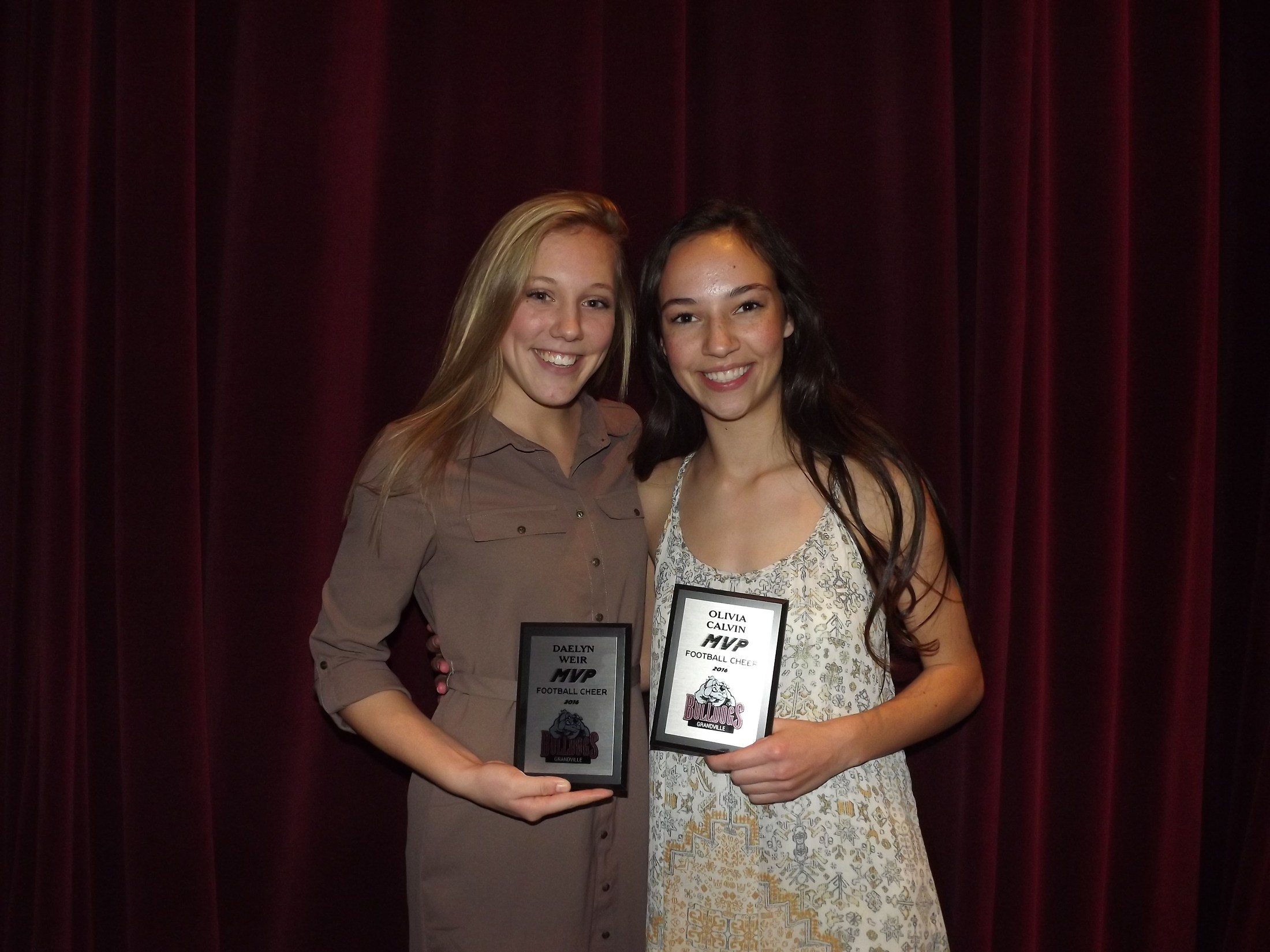 girls with cheerleading MVP award