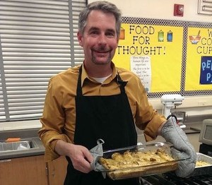 Picture of Associate Superintendent, Tom Avvakumovits at a cooking class.