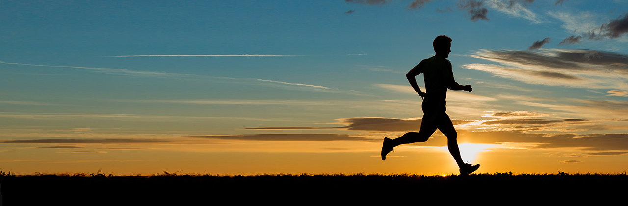 runner silhouette with sunset background