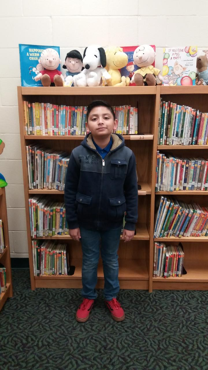 Juan in front of bookcase