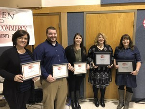 teachers holding awards